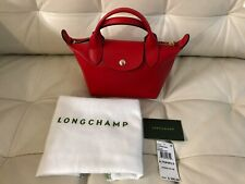 Longchamp Mini Le Pliage Cuir Leather Top Handle Bag in Red