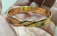 Vintage Monet Bangle Bracelet Gold Tone Hinged Textured Design Ribbon Front 3/8""