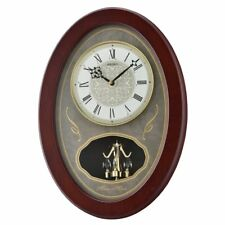 Seiko Oval Melody In Motion 17H in. Wall Clock with 4 Swarovski Crystals, Brown