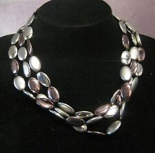 Wonderful triple strand of oval plastic silver beads with nice clasp