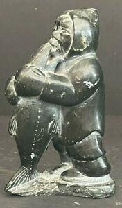 Signed Inuit Stone Carving of Man with Fish