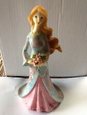 Serene Flower Girl Figurine With Pink Dress