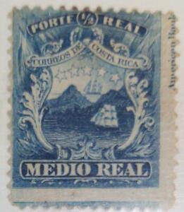 A) 1864, COSTA RICA, NATIONAL EMBLEM, IMPRESSION RUNNED TO THE LEFT SIDE AND CUT