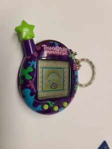 VTG Tamagotchi Connection Purple w/ Puzzle Pieces Tested Works 2004 FS