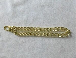 Stylish gold tone chain bag charm*.