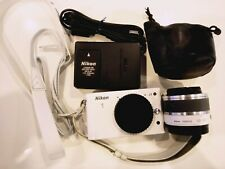 Nikon 1 J1 10.1MP Digital Camera - White (Kit w/ VR 10-30mm Lens + hand strap)