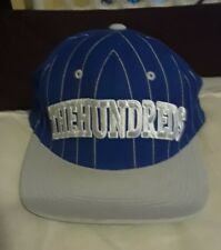 The Hundreds Pins adjustable Snapback Cap blue w/ gray letters, stripes, & brim.