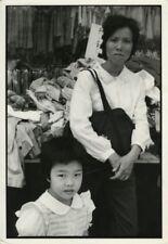 Asian Lady & Child Cloth Shop Chris Mackey Photo 1986