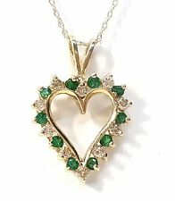 "Emerald  & Diamond Heart Pendant in 14kt. Yellow Gold. 30pts. Dia's t.w. 1"" High"