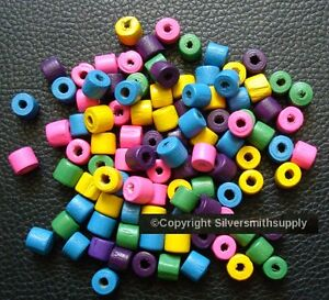 """100 7x6mm  Wood drum beads assorted colors 1-2mm hole 25"""" When Strung WB013"""