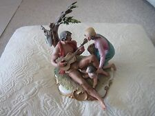 GIUSEPPE CAPPE ITALIAN PORCELAIN FIGURINE MAN PLAYING GUITAR FOR WIFE AND BABY