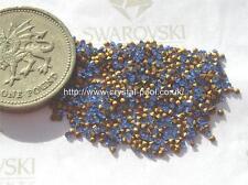 60 x Swarovski 2SS / 5pp saphir gold-foiled # 1100 chatons