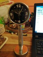 Small chrome Clock On Chrome base with Spring Battery operated black face