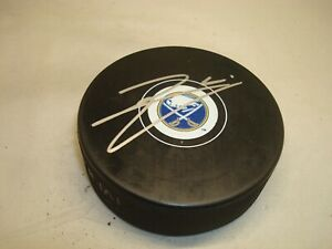 Remi Elie Signed Buffalo Sabres Hockey Puck Autographed 1A