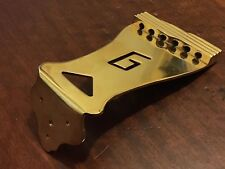 GRETSCH ''G'' CUTOUT TAILPIECE CHROME 5.5 IN GOLD FINISH. OLD STOCK. NEVER USED.