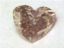 ARGYLE MINES VVS NOT ENHANCED HEART CUT FANCY CHAMPAGNE DIAMOND .51 CT
