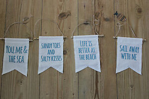 FABRIC BANNER WITH NAUTICAL/BEACH THEMED PHASES .SANDY TOES/BETTER AT THE BEACH