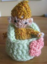 HAND KNITTED MAGICAL AUTUMN ELF BABY IN BASKET. 4 INCHES TALL. 2 PC. SET.
