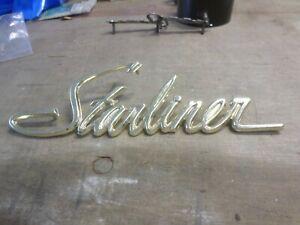 NOS 1960 ford starliner script gold