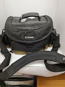 Genuine branded Canon Camera Bag and strap.