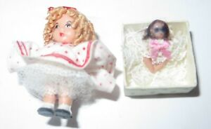 Miniature dollhouse Little girl with doll in a box