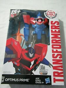TRANSFORMERS OPTIMUS PRIME ROBOTS in DISGUISE