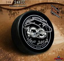 Joe Sakic Signed NHL100 Official Game Puck with HOF 2012 Inscription Ave's