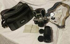 Canon AE-1 Camera + case, Zoom lenses,  filters, manual + Albinar carrying bag