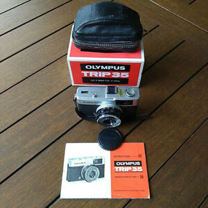 Olympus Trip 35,  carry bag, lens cap, box and book..silver button Jan 1978