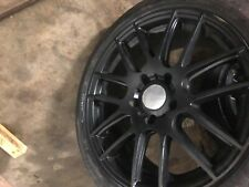 Bmw 17 inch black rims with tires two good tires and other two are ok Obo trades