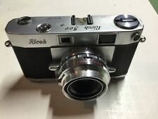 Vintage Ricoh 500 camera With leather case untested Nice condition