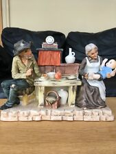 """Delightful pottery scene of old couple and baby in a rustic home - signed """"Gino"""""""