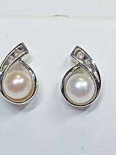 PEARL + DIAMOND PIERCED EARRINGS    RETAIL  $ 450.00