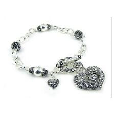 Silver Toned Charm Bracelet With Filigree Double Heart Charms