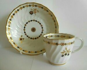 ANTIQUE FLIGHT WORCESTER PORCELAIN SPIRAL FLUTED COFFEE CUP AND SAUCER