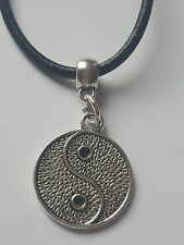 YIN YANG SILVER TONE TIBETAN CHARM PENDANT ON BLACK LEATHER CHOKER NECKLACE.