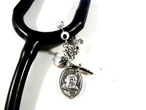 stethoscope ID tag rosary evil eye choice of Saints, colors medical St. Pio RN