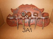 Antique wall hanging pipe rack including pipes