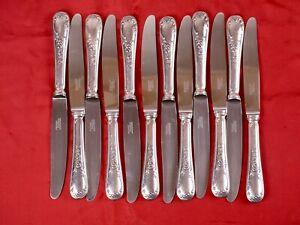 François Frionnet, 12 beaux couteaux de table métal argenté, lame ino