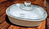 Covered casserole french white big bowl by Corning with pyrex Lid