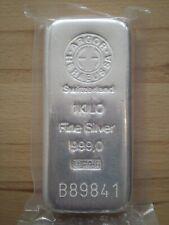 1 Kg. Silberbarren der Firma Heraeus- Argor eingeschweißt