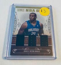 B10,925 - 2010-11 National Treasures NBA Gear Trios #34 Daniel Orton Jersey #/99