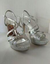 Nine West silver glitter hot list strappy platform heels, size 10