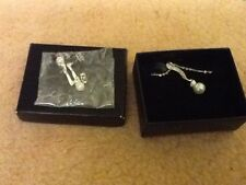 Pearl effect necklace and earring set. Boxed. New from Avon .