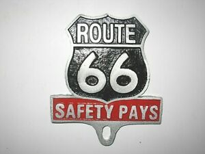 LICENSE PLATE TOPPER, ROUTE 66,SAFTY PAYS, SAND CAST ALUMINUM,5 INCHES X 5 1/2