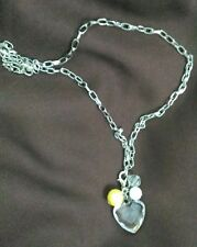 Silver link chain with lobster claw and dangling removable charm.  11.5 inches.