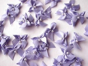 40 SMALL LOVELY BOWS WITH ADDED TINY PEARL CENTRE, 20MM WIDE, VARIOUS COLOURS