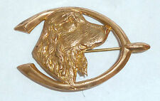 A VINTAGE 1930s GOLD TONE DOG WITH GOOD LUCK WISHBONE BROOCH