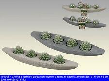 Ciotola portacandele a forma di barca con 4 candele a forma di cactus