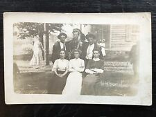 REAL PHOTO POST CARD  Family with man in uniform c. 1902
